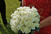 Wedding posie with white roses and diamonds and bear grass and camellia leaves