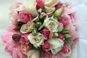 Mixed wedding posie with peony roses and bright pink roses