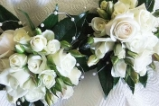 White wedding posie with white roses and camellia leaves and pearls