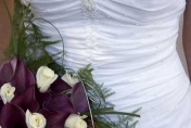 Hand tied wedding bouquet with white roses and calla lilies