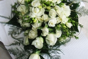 Trailing wedding bouquet with white roses and white freesias and fern