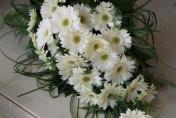 Trailing wedding bouquet gerberas with bear grass