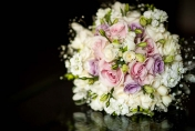 Hand tied wedding posie with white and pink roses and diamonds