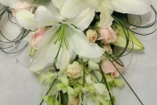 Trailing wedding bouquet with white lillies and singapore orchids and roses