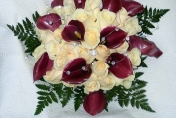 Wedding posie with cream roses and burgundy calla lilies and fern