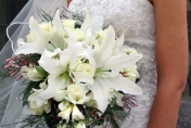 Trailing wedding bouquet of white roses, white lilies and jasmine