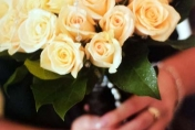 Wedding bouquet with champagne roses and camellia leaves