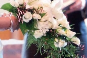 Trailing wedding bouquet with white lilies, white roses and jasmine