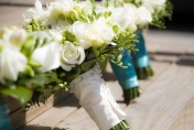 Hand tied wedding bouquet with cream roses and cream freesias