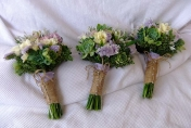Hand tied rustic wedding bouquet with twine, white roses, and succulents