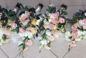 Natural hand tied trailing wedding bouquets in soft pastels with lace