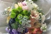 Natural hand tied wedding bouquet with lime green chrysanthemums, mauve roses, white stock, peach alstroemeria lilies, grey folliage