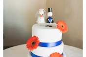 Wedding cake floral decorations with orange gerberas