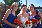 Hand tied white and orange gerbera wedding bouquet