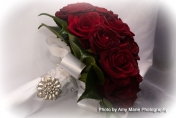 Red roses wedding posie with camellia leaves finished with white ribbon
