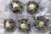 Hand tied lime green and mauve wedding bouquets