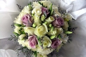 Wedding posie with mauve and pink roses and lisianthus