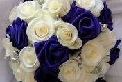 White roses and silk ribbon roses wedding bouquet and pearls and diamonds