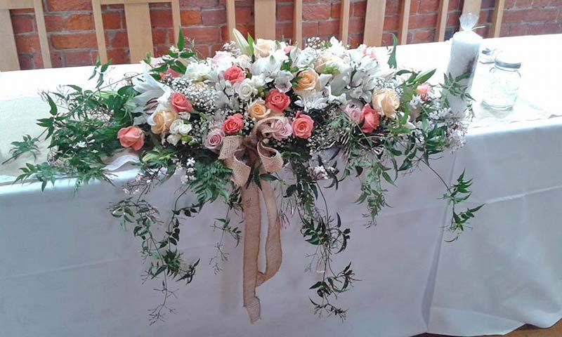 Head Flowers Arrangement With Trailing Jasmine Roses