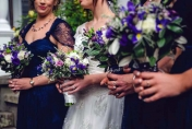 Wedding bouquet hand tired. Iris, lime green spray chrysanthemums, gypsophila, roses, spray carnations, lisianthus, freesias, purple mauve, white tones.