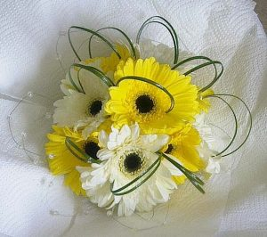 Wedding bouquet white white and yellow gerberas with bear grass
