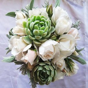 Hand tied wedding posie with white roses and succulents
