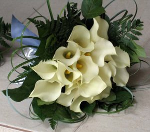 Hand tied wedding bouquet with white calla lilies and fern
