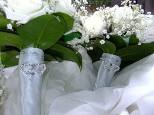 Silk wedding posies with white roses and gypsophila and camellia leaves