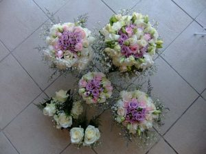 Cream mauve roses with lys and gypsophila
